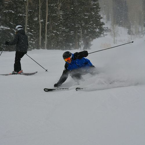 People Snowboarding On Snow Covered Field During Winter