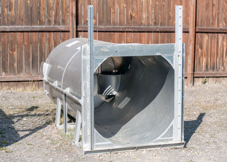 a humane bear trap, used to trap bears alive so that they can be cared for, relocated, or moved to a safe area Humane Bear Trap Safe Park Danger Conservation Cage Steel Steel Structure  Transportation Equipment Container Mobile Animal Wildlife Control