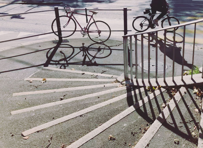 High angle view of bicycle parked on railing