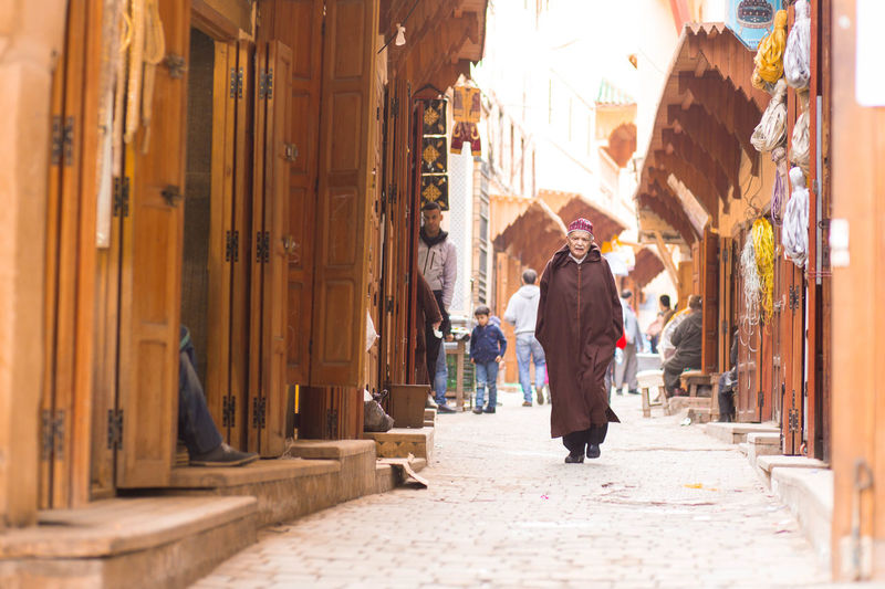 City Center Man Medina Adult Architecture Building Exterior Built Structure City Clothes Day Full Length Jellaba Lifestyles Men One Person Outdoors People Real People Street Photography Waling Around Walking Women