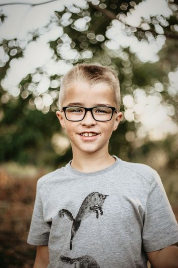 Portrait of boy wearing eyeglasses outdoors
