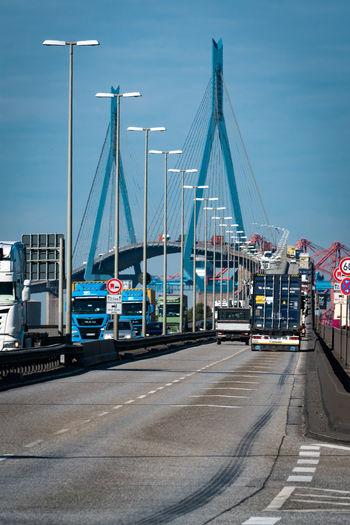 View of bridge over city against sky