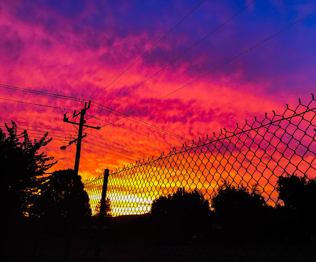 Beautiful sunset at Myrtleford, Victoria, Australia. Sky Sunset Fence Barrier Boundary Silhouette Cable Security Cloud - Sky Safety Orange Color Technology Protection Nature Power Line  No People Electricity  Electricity Pylon Connection Chainlink Fence Outdoors Power Supply Australia Victoria Myrtleford Red Sky At Sunset