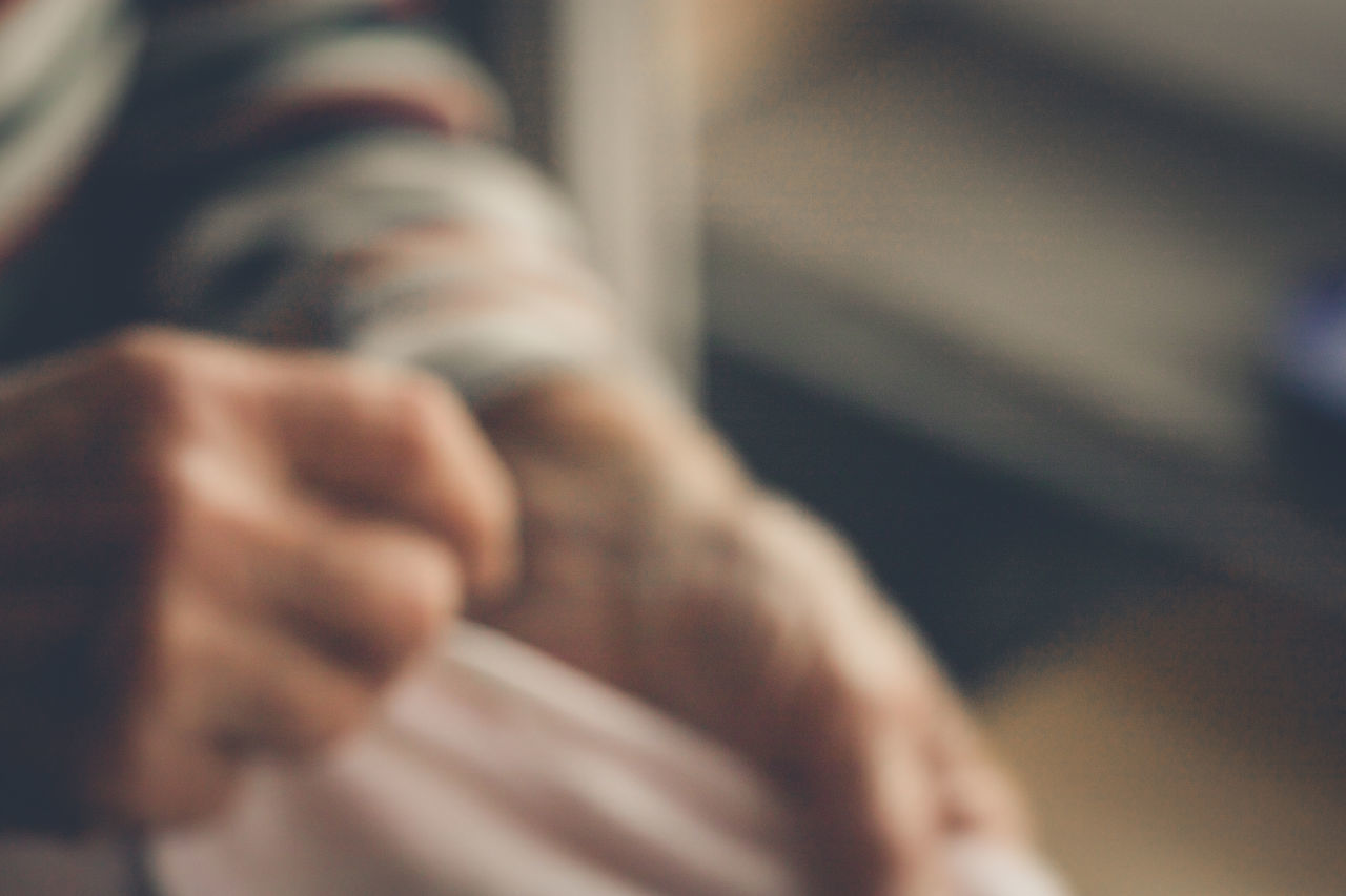 human hand, selective focus, human body part, hand, body part, real people, people, close-up, finger, indoors, human finger, men, unrecognizable person, personal perspective, gesturing, emotion, two people, day, lifestyles, human limb