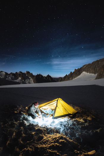Check out my prints at http://simonmigaj.com/shop/ and visit my IG http://www.instagram.com/simonmigaj for more inspirational photography from around the world. Sky Star - Space Night Beauty In Nature Scenics - Nature One Person Tent Nature Camping Tranquility Real People Leisure Activity Astronomy Mountain Tranquil Scene Star Adventure Outdoors Alps Mountains Mountains And Sky Extreme Close-up Astrophotography Glacier France