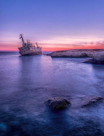 Beach Beauty In Nature Cloud - Sky Coastline Horizon Over Water Industry Land Nature Nautical Vessel No People Outdoors Purple Scenics - Nature Sea Ship Sky Sunset Tranquil Scene Tranquility Transportation Water