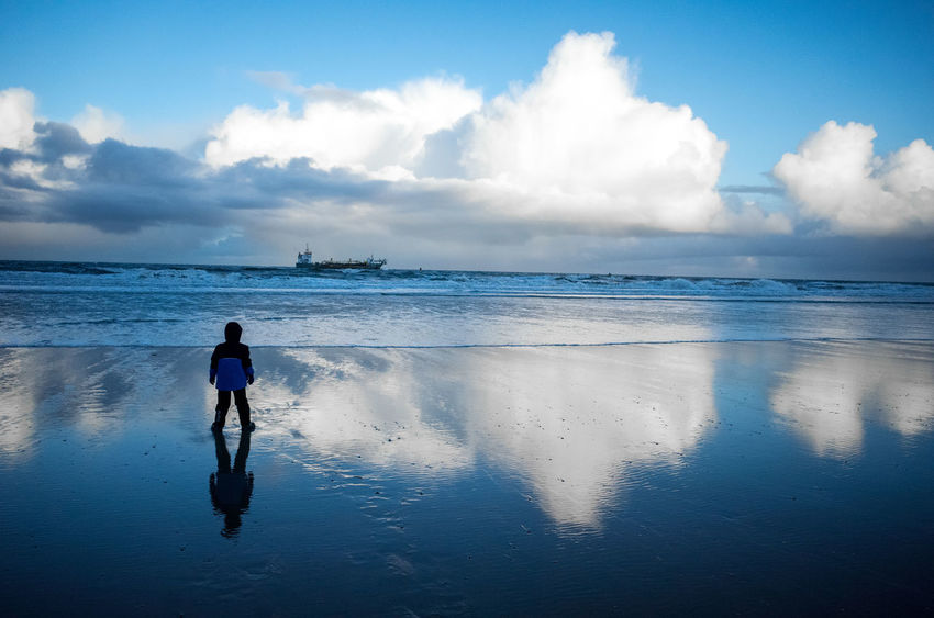 Big Boy Nature Beach Beauty In Nature Boy Cloud - Sky Day Full Length Horizon Over Water Leisure Activity Lifestyles Men Nature Ocean One Person Outdoors People Real People Rear View Scenics Sea Ship Sky Standing Walking Water