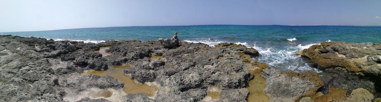 Panoramic view of sea shore against sky