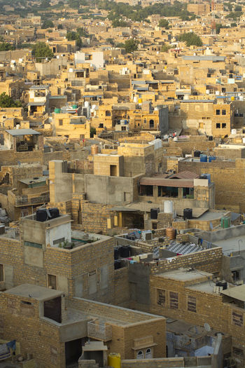Jaisalmer India Golden Color Architecture Building Exterior Built Structure City Building Residential District High Angle View Crowd Crowded Cityscape Roof House Day Community Outdoors Travel Destinations Town Backgrounds TOWNSCAPE Apartment Housing Development Settlement