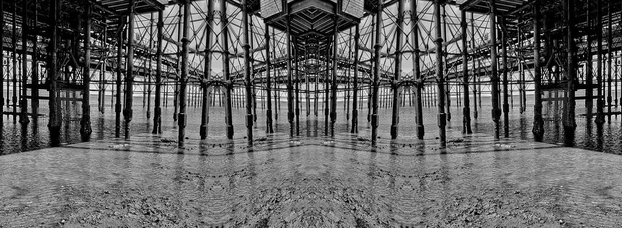 Under the pier, there is no escape. Manipulation of events. Abstract Abstraction Angles Angles And Lines Architectural Column Black & White Black And White British Seaside Empty Industrail Metal Structure Metal Struts Mirrored Forms No Escape No People Pier Pier In Southend Southend On Sea Southend Pier Structure Structure In Silhouette The Innovator Under The Pier Strange Spaces