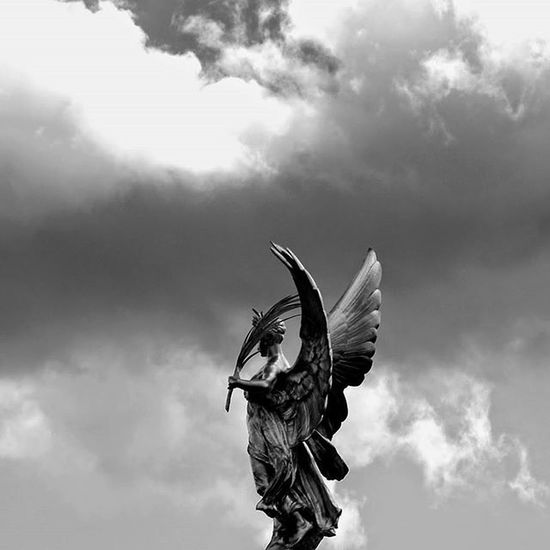 An angel in the sky Angel Sky Clouds Cloudscape Londonart Streephotography Streetart Monument Blackandwhite B_w Vision Pictureoftheday Picoftheday Nicepic London Londonlife Travelingtheworld  Ontheroad LondonStyle