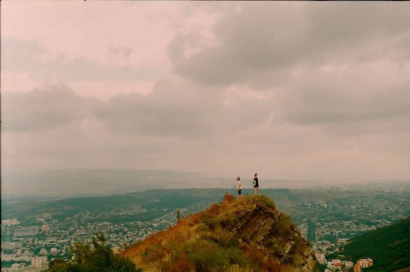 Tbilisi Sky Two People Cloud - Sky Mountain Landscape Outdoors Real People Architecture Beauty In Nature Nature Scenics Togetherness Day Cityscape People Adult Adults Only