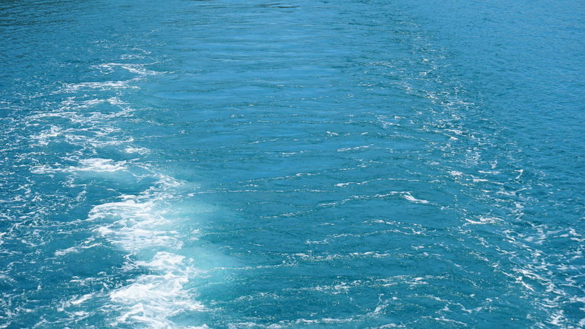blue sea Water Backgrounds Blue Sea Textured  Rippled Close-up Clear Turquoise Rushing Water Surface Calm
