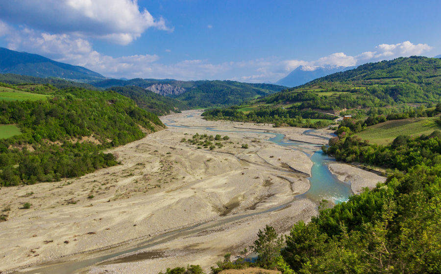 Albania River Bed Beauty In Nature Cloud - Sky Day Dried River Environment Land Landscape Mountain Mountain Range Nature No People Non-urban Scene Outdoors Plant Road Rural Scene Scenics - Nature Sky Tranquil Scene Tranquility Tree Water