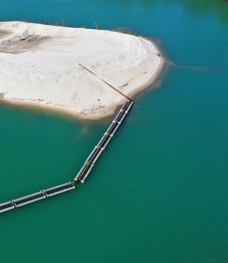 Abstract aerial view of a sand tongue in a gravel pond