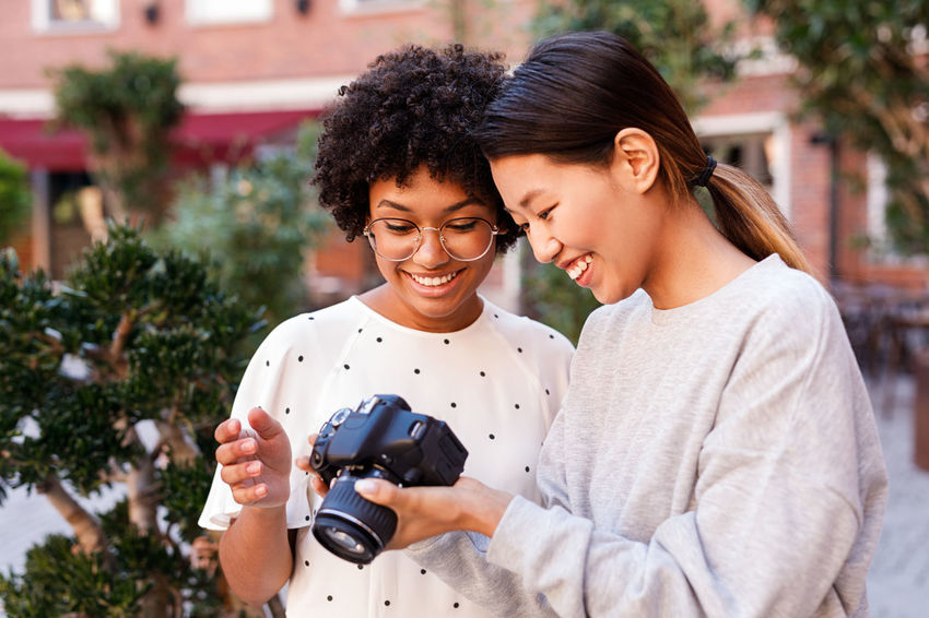 Two People Togetherness Positive Emotion Standing Photographer Client Blogger Smiling Happy Camera DSLR Young Outdoors Posing Happiness Shooting Review Photos Portrait Personal
