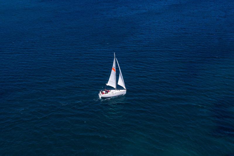 High angle view of sailboat sailing in sea