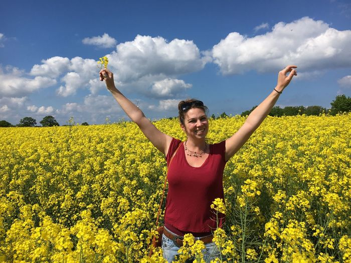 Field Flower Yellow Growth Real People Nature Cloud - Sky One Person Sky Agriculture Leisure Activity Outdoors Day Lifestyles Freshness Oilseed Rape Plant Happiness Young Adult