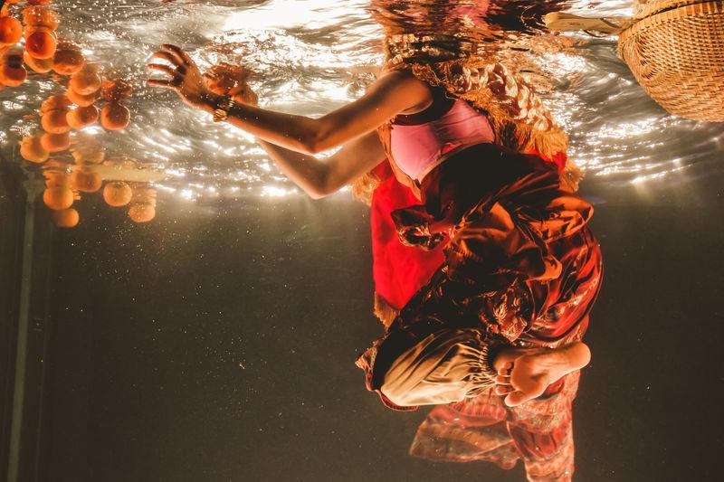 Woman Swimming In Water