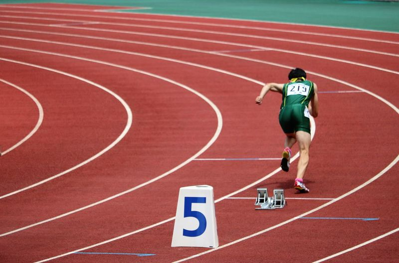 Full length of a man running on sports track
