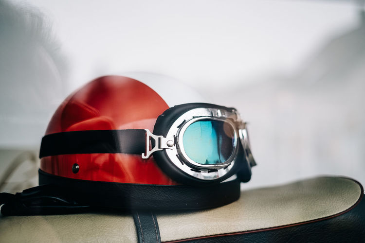 Close-up Still Life Focus On Foreground Table Indoors  No People Personal Accessory Reflection Fashion Red Technology Security Two Objects Glasses Selective Focus Protection Single Object Black Color Headwear Eyewear Luxury Helmet Vintage
