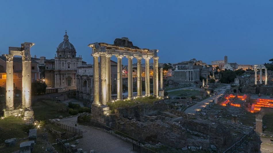 Sunset over Forum Romanum (Fori Romani) ancient site of antique city of Rome near Palatino hill Coliseum Quirinale Rome Viminale Europe Fori Romani Italy Trevi