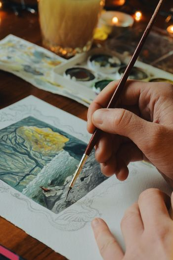 Close-up of hand painting watercolor
