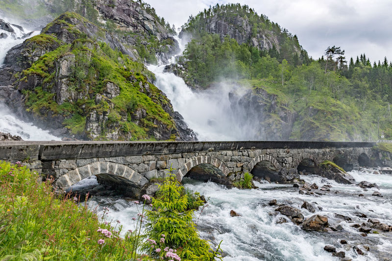 Langfossen Norway Beauty In Nature Bridge - Man Made Structure Day Lattefossen Long Exposure Motion Mountain Nature No People Odda Outdoors Power In Nature River Rock - Object Scenics Sky Summer Tree Water Waterfall Wilderness