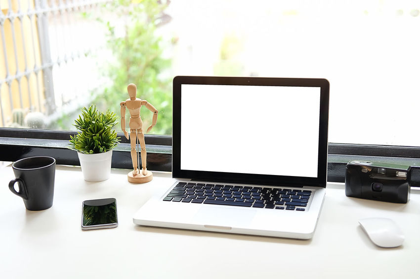 Office desk Work space stuff with notepad, laptop and coffee cup mouse notepad shot. Adult Business Coffee Cup Communication Computer Connection Cup Desk Drink Furniture Glass Indoors  Laptop Mug Plant Portable Information Device Screen Table Technology Using Laptop Wireless Technology