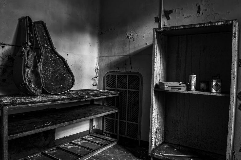 Abandoned Bad Condition Black And White Case Corner Damaged Dirty Flamable Grunge Guitar Indoors  Liquids  Locker No People Ruined Scary Shadow Shelf