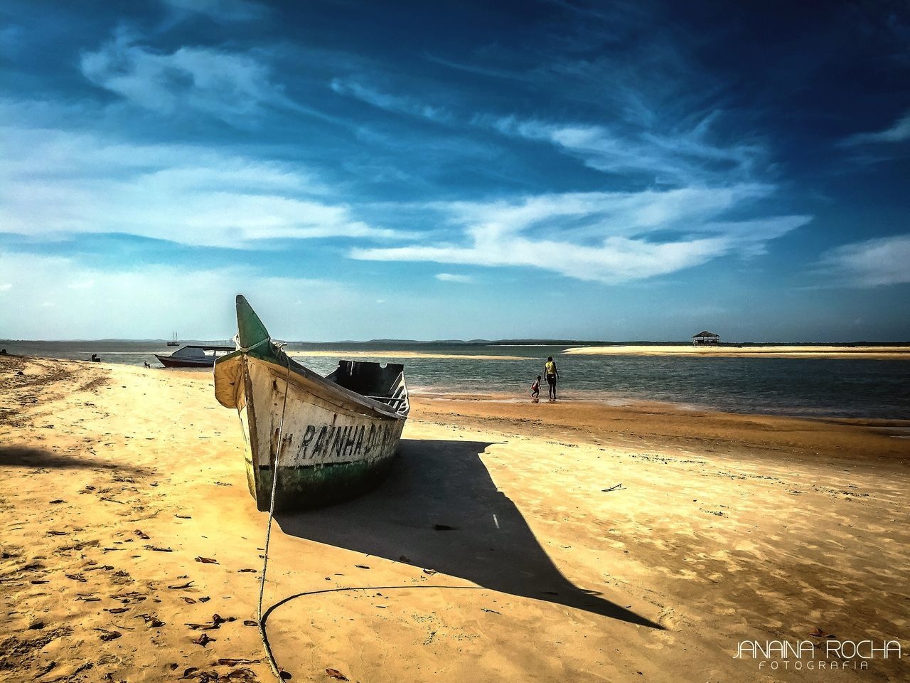 beach, sand, sea, nautical vessel, shore, horizon over water, water, nature, sky, boat, beauty in nature, transportation, scenics, mode of transport, tranquility, outdoors, day, cloud - sky, tranquil scene, full length, moored, standing, one person, longtail boat, real people, outrigger, people