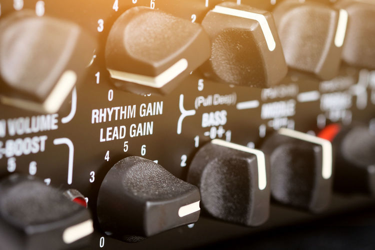 detail of Guitar Amplifier Music Amplifier Art And Entertainment Close-up Concert Guitar Guitar Amplifier Indoors  Knob Music Studio  Musical Instrument Musician No People Sound Mixer Sound Recording Equipment Technology Text
