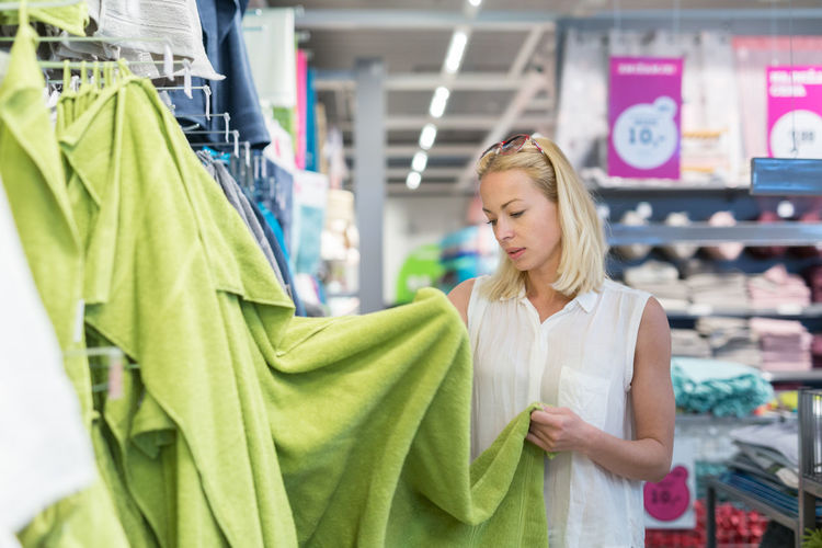 Mid adult woman standing at departmental store