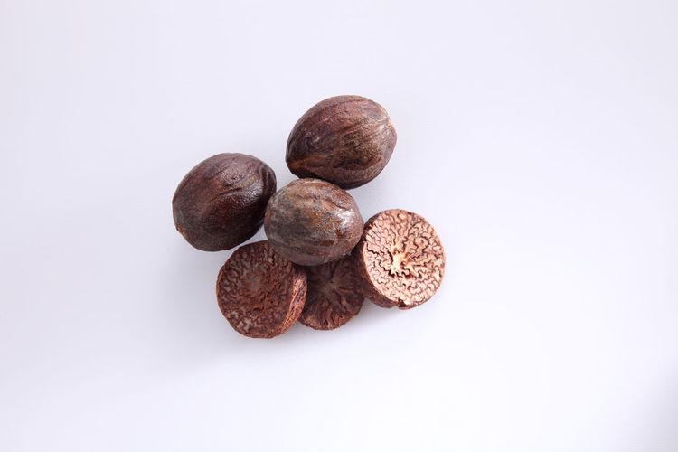Close-up of nutmeg over white background