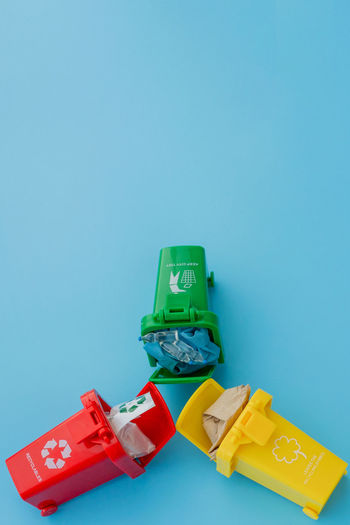 High angle view of toy against blue background