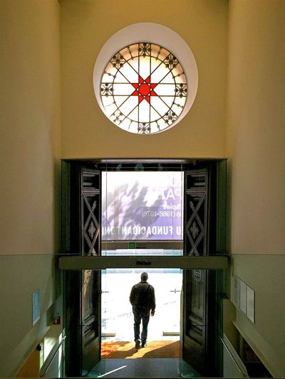 361 / 366 Arts Culture And Entertainment Framed Geting Out Indoors  Men Only Men People Silhouette Silouette And Shadows Vantage Point
