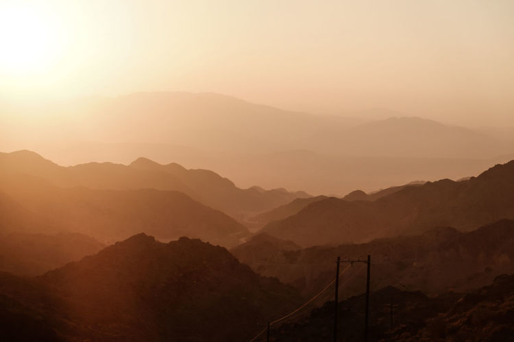 Sunset over layers of mountain range in iran.