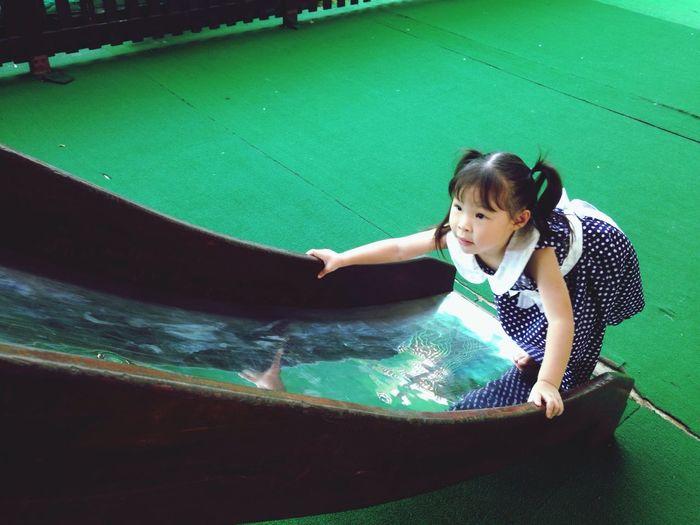 High angle view of girl playing on slide