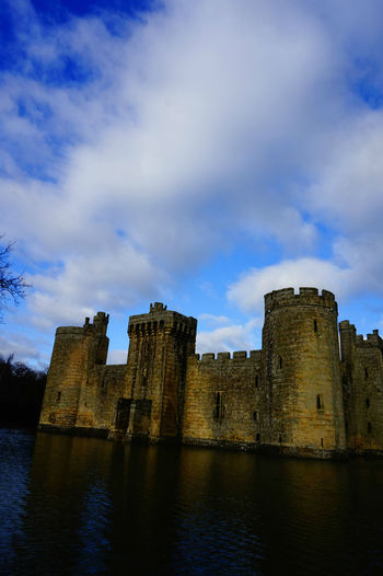 beautiful sky on the top of the historical castle Architecture Blue Sky Blue Sky And Clouds Bodiam Castle Building Exterior Built Structure Castle Castle Famous Place History Medieval Medieval Architecture Moat Old Old Ruin Outdoors Ruined Sky Sky And Clouds Tower White Clouds