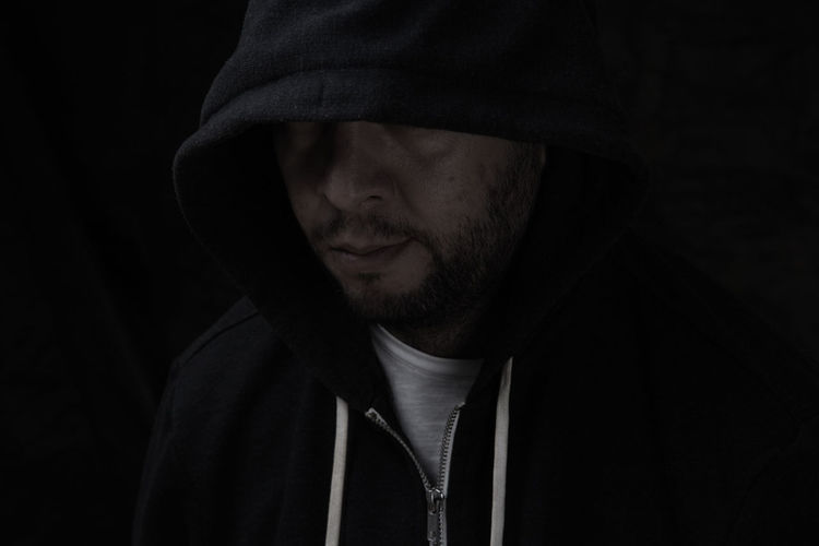 Strange Man Hooded Man One Person Hood Clothing Hooded Shirt Hood - Clothing Headshot Black Background Lifestyles Beard Front View Portrait Studio Shot Indoors  Real People Men Facial Hair Close-up Leisure Activity Mid Adult Men Dark Human Face Obscured Face
