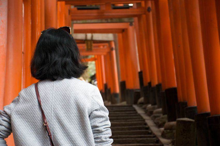 Walking the vermillion shrines of Fushimi Inari-taisha in Kyoto, Japan. Climbing Stairs Walking Path Architecture Orange Color Place Of Worship Spirituality Shrine Architectural Column Kyoto Japan Travel Destinations Vermillion Reverence Blessings Dedication In A Row Ancient Architecture Tourism In Awe