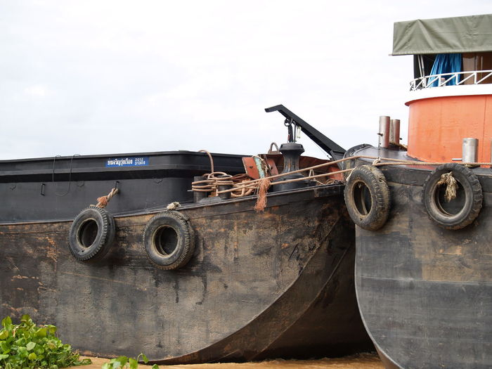 Abandoned truck against sky