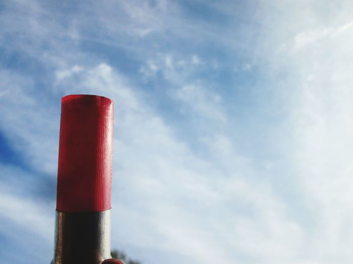 Low angle view of red smoke stack against sky
