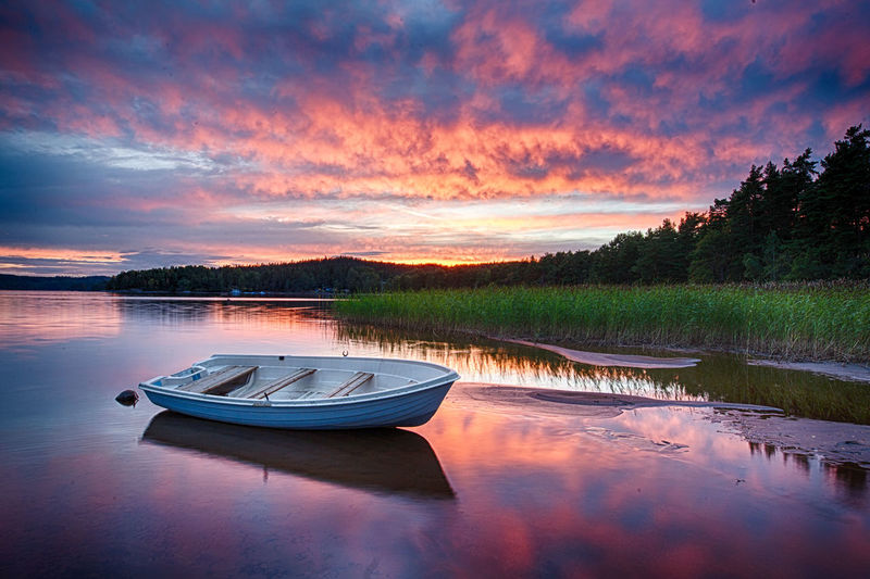 down by the lake, the sky is on fire HDR Holiday Sweden Beautiful Sunset Beauty In Nature Boat Lake Landscape Nature Nautical Vessel Outdoors Reflection Romantic Sky Rowboat Scenics - Nature Sunset Tranquil Scene Water