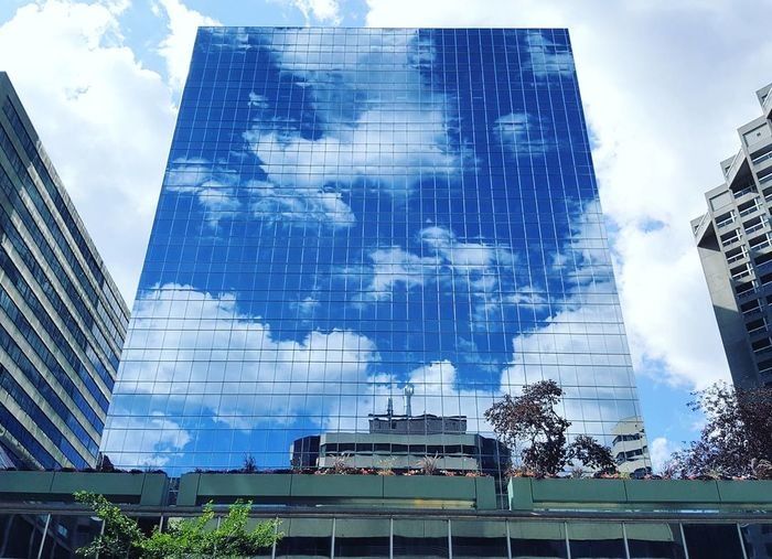 Day No People Inanimate Objects Low Angle View Blue Architecture Outdoors Illuminated Collectivity City Life Sun Colour Mirror Effect Reflection Photography Cloud And Sky Cloudporn Glass Reflection