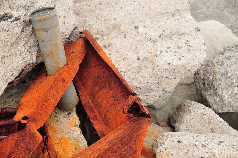 Rusty scrap metal girder on rubble