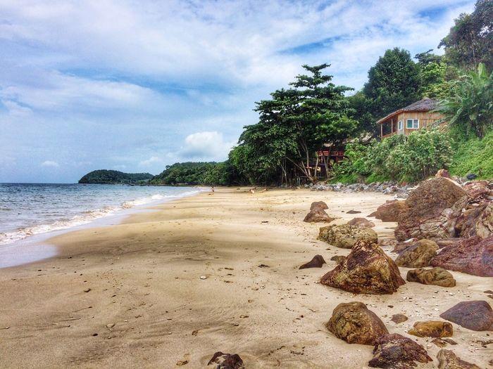 ชายหาด Sky Beach Sand Tree Sea Cloud - Sky Nature Water No People Tranquility Landscape Architecture Outdoors Day Beauty In Nature