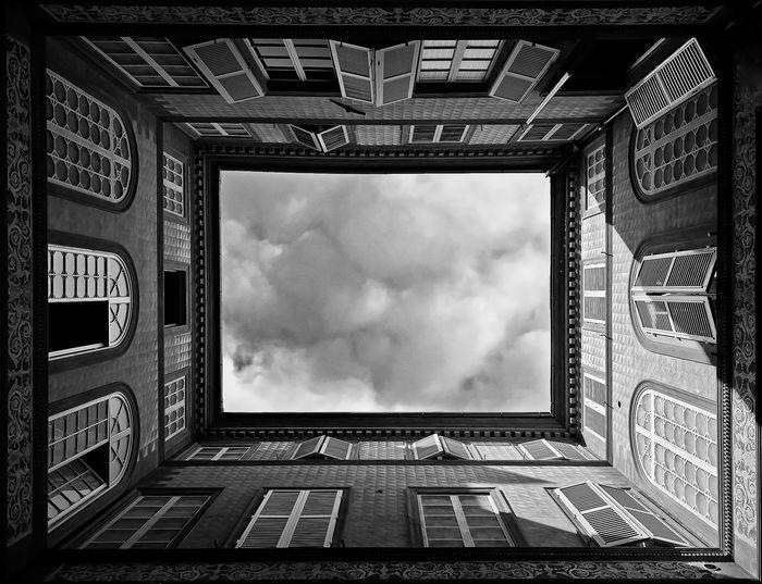 Directly below shot of skylight seen through historic building skylight