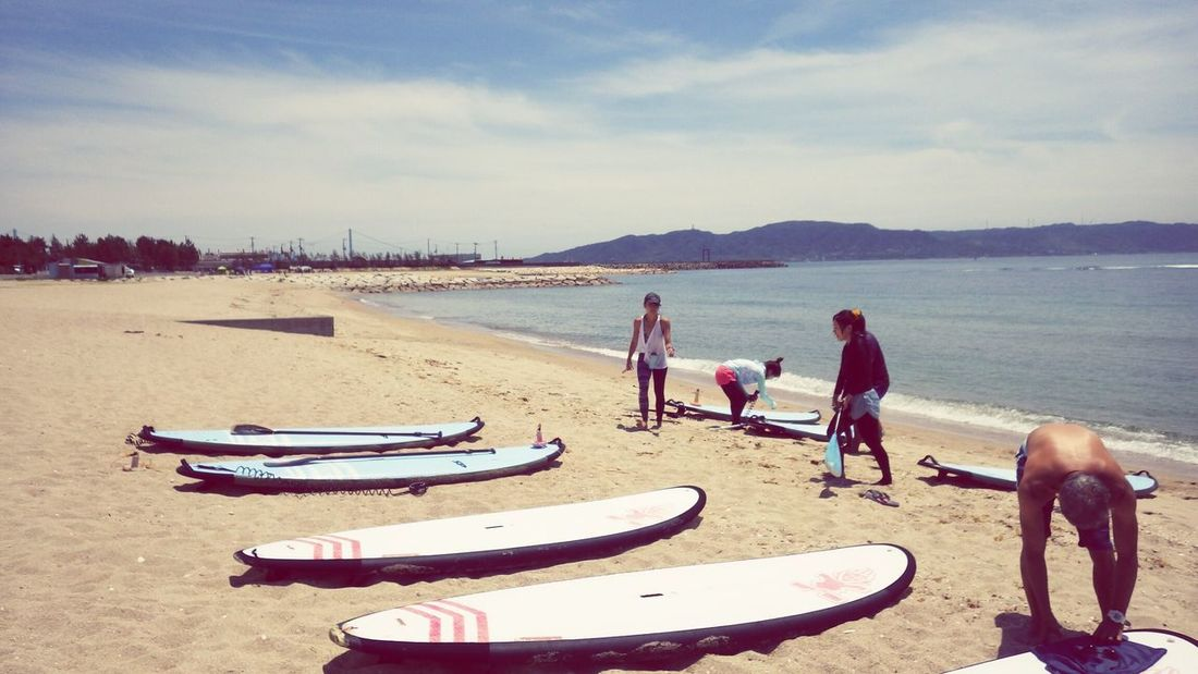 SUP DEBUT Beach Sand Water People Sea Togetherness Full Length Adult Dog Men Pets Outdoors Day Lifestyles Sky Adults Only Nature Friendship Friend ✌ Friends Sup StandupPaddleBoard Standuppaddle