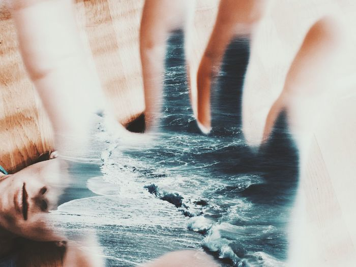 Blurred motion of people in sea